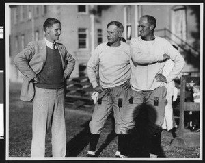 University of Southern California football coach Howard Jones, Al Wesson, and Bill Hunter at Bovard Field, USC campus, late 1920s