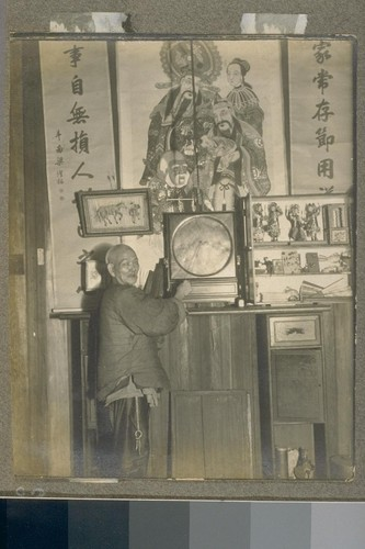 [Unidentified man. Interior, Chinese church or temple?]