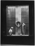 [Exterior night shot display window Bullock's Wilshire building.]