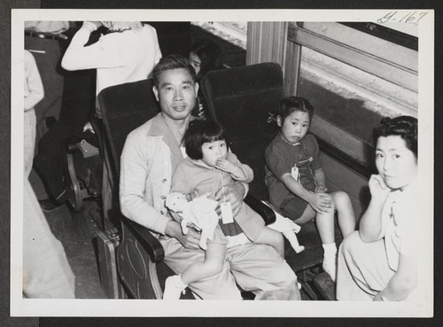 Topaz family settled down in Tule Lake bound train. Topaz, Utah