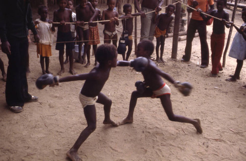 Children boxing inside ring, San Basilio de Palenque, 1976