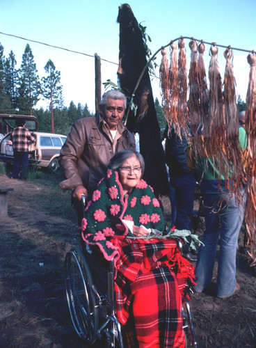 Marie Potts with unidentified man in front of the bearskin and the maple bark flag at the Janesville Bear Dance--1977