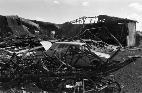 Destroyed building and car, Managua, 1980