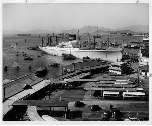 """PRES. MONROE docked in Hong Kong, bus terminal in foreground. Raymond L. Pound Dec. 1947"" (print only; no neg)"