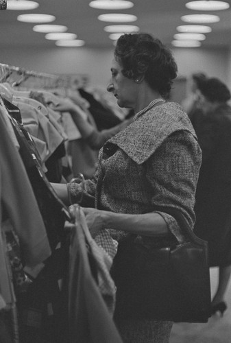 Woman looking through clothes rack, San Francisco