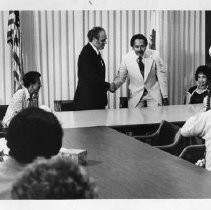 Benjamin Hooks, the American Civil Rights leader, is greeted by Lt. Gov. Mervyn Dymally and legislators at an NAACP meeting. Hooks, a minister and attorney, served as the executive director of the NAACP from 1977-1992