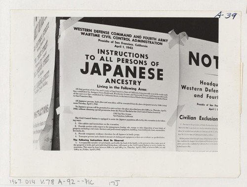 Exclusion Order posted at First and Front Streets directing removal of persons of Japanese ancestry from the first San Francisco section to be affected by evacuation. Evacuees will be housed in War Relocation Authority centers for the duration. Photographer: Lange, Dorothea San Francisco, California