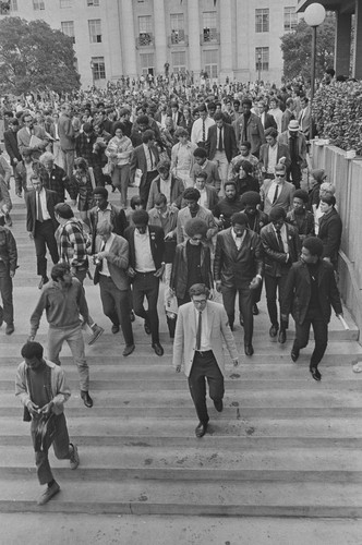 After rally at University of California campus, Eldridge and Kathleen Cleaver leave, Berkeley, CA, #115 from A Photographic Essay on The Black Panthers
