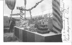1911 Gravenstein Apple Show display of apples with an exhibit by Forestville visible in background