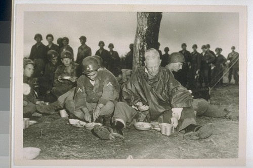 Governor Earl Warren (right) of California eating lunch with CPL Marian Sheppard (San Marino, Calif.)