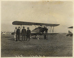 [Biplane sitting on airfield]
