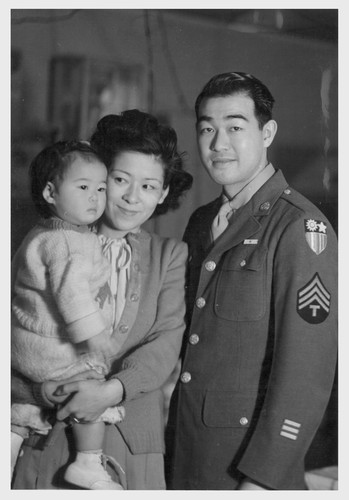T/4 Taniguchi visits his wife and daughter at the Minidoka Relocation Center before returning to his unit in the Pacific