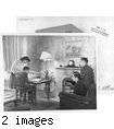 """They're Japanese--but loyal Americans. Here is another typically American scene in the home of a loyal Japanese-American family. While Mr. And Mrs. Kaytaro Tsukamoto, right, look on, their son, Wilmer, gets some assistance with his school homework form Miss Sachi Yasukochi, his aunt.""--caption on photograph JARDA-1-36"