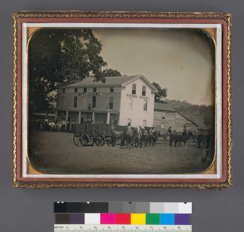 [Smith's Exchange, Natoma Valley, with wagons and teams in front of building.]