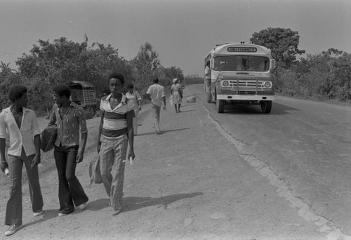 People at bus stop, Cartagena Province, ca. 1978
