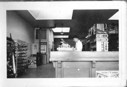 Delbert triggs at the counter in J. F Triggs & Son Auto parts store April, 1939 at 130 South Main Street, Sebastopol