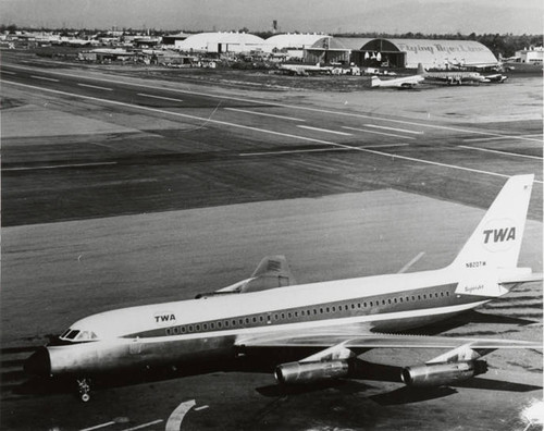 Lockheed L-1049 Constellation which was owned and operated by the Flying Tiger Line; in the foreground is TWA's Convair 880