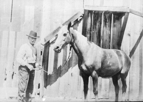 Frank Hartman with his horse