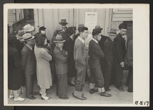 In response to the Army's Exclusion Order No. 20, residents of Japanese ancestry appear at Civil Control Station at 2031 Bush Street, for registration. The evacuees will be housed in War Relocation Authority centers for the duration. Photographer: Lange, Dorothea San Francisco, California