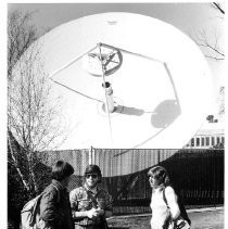 "Caption reads: ""Students Tony Raetz, left, Chris Johnson, and Tammy Davis are accustomed to the giant satellite dish on the Chico campus."""