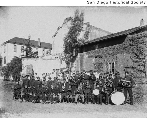 A Native American band standing near the Mission San Diego de Alcala