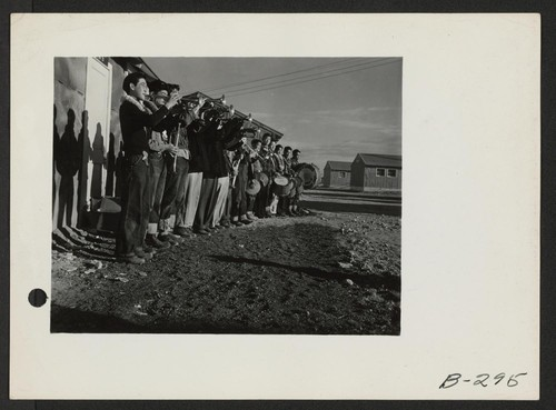 A Boy Scout band in full regalia greeted the evacuees from Hawaii when they arrived at this center. Photographer: Stewart, Francis Topaz, Utah