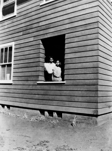Two Wilson children (looking out of window)