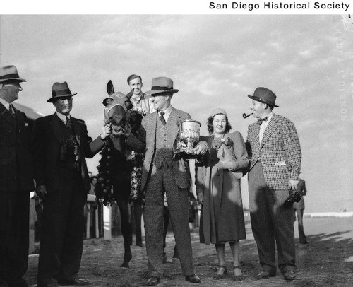 Race horse Seabiscuit with his trainer Tom Smith, Bing Crosby, and others