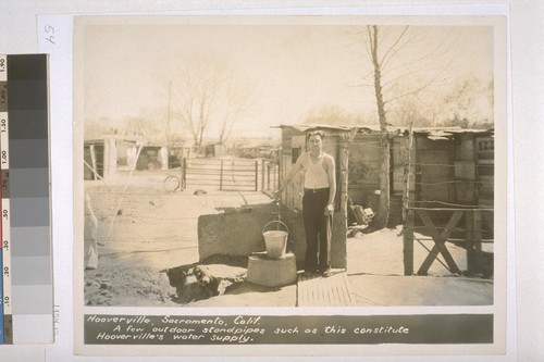 Hooverville, Sacramento, California. A few outdoor standpipes such as this constitute Hooverville's water supply