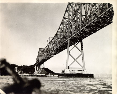 [View from below of San Francisco-Oakland Bay Bridge cantilever section under construction]