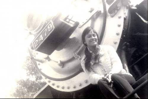 Patricia Whiting in front of a train