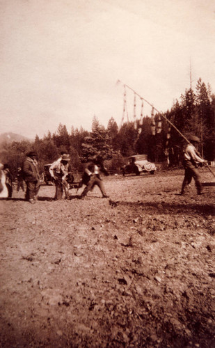 People following the Maple Bark Flag at an Early Bear Dance in Plumas County
