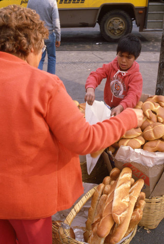 A young boy selling bread, Mexico, ca. 1983