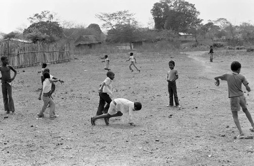 Boys playing in a dirt field, San Basilio de Palenque, 1977