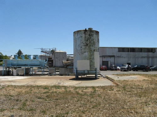 Tanks and apple processing machinery outside the north end of the Barlow Company building, Sebastopol, Calif., June 17, 2009