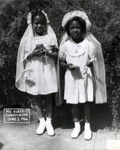 Two girls celebrating First Communion, Marin City, California, June 2, 1946 [photograph]