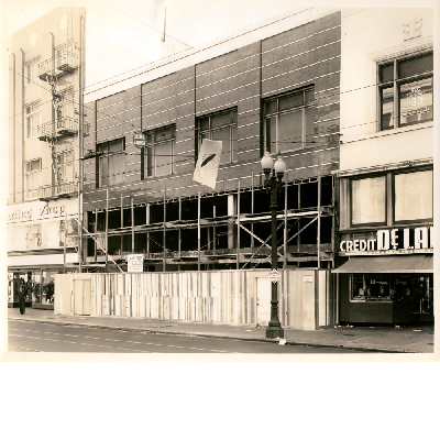 City Market building, east side of Washington Street between 12th and 13th Streets in downtown Oakland, California. Hughes Women's Apparel undergoing remodeling