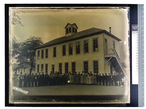 [Children and teachers pose in front of building on Hoopa Valley Reservation]