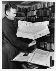 Theodore Marshall, S.J., with manuscript