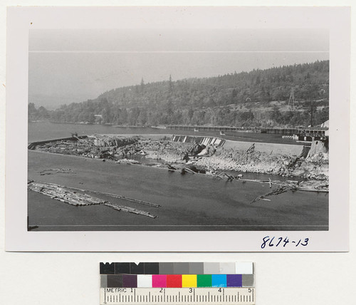 Falls at Oregon City. Power house is just below this. Booms of logs going to mill on east side of river. Big Weyerhaeuser paper plant on west side. Metcalf. Oct. 1952