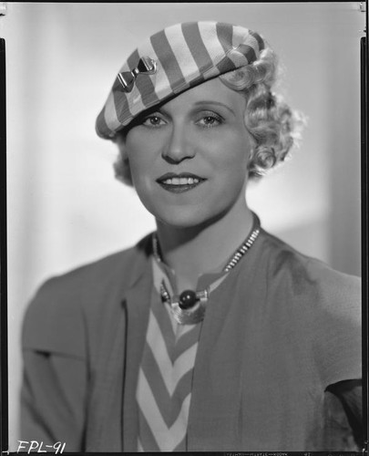 Peggy Hamilton modeling a striped cap with a matching dress, circa 1933