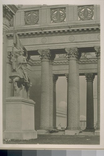 "H39. [""Cortez"" (Charles Niehaus, sculptor) and colonnade, south facade, Tower of Jewels (Thomas Hastings, architect).]"