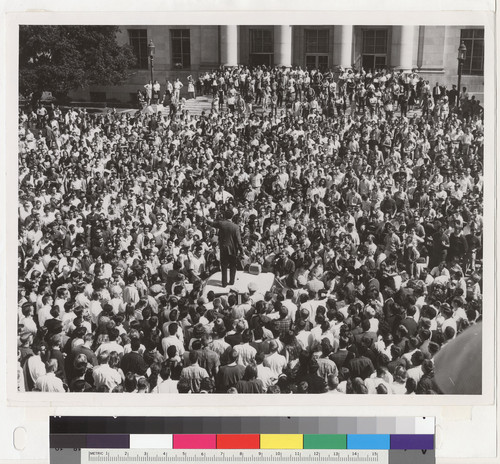 View of students in Sproul Plaza surrounding police car, October 1, 1964. Mario Savio speaking from roof of car