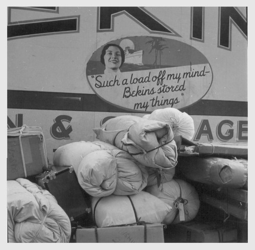 Hayward, Calif.--Baggage of evacuees of Japanese ancestry ready to be loaded on moving van. Evacuees will be housed in War Relocation Authority centers for the duration. Photographer: Lange, Dorothea Hayward, California