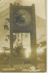 1913 Gravenstein Apple Show display of a pendulum clock made of whole and dried apples