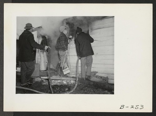Quick work, by the evacuee fire department, kept the fire which broke out in the office located at the old hog farm from doing other than minor damage. Photographer: Stewart, Francis Newell, California