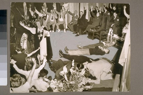 Led by Aimee Semple McPherson, delegates to the 19th annual Four Square Gospel Church Convention yesterday wept, sang, prayed and fainted in the ecstacy of prayer during the Holy Ghost Rally pictured here