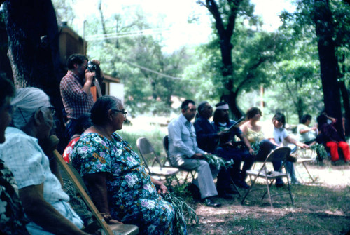 Tom Merino and Seymour Smith (seated, in center) at the Greenville Bear Dance--1984