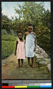 Boy and girl standing on a grassy path, Tanzania, ca.1920-1940