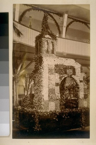 [Flower-covered exhibition booth, also pictured in no. 19]